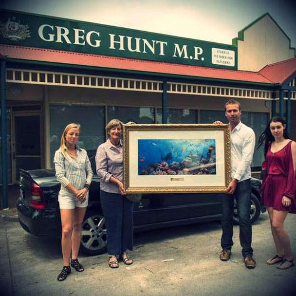 Greenpeace activist and Reef lover Gillian Trahair delivered this beautifully framed photo of the Great Barrier Reef to Environment Minister Greg Hunt's electorate office.