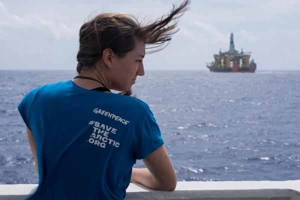 Miriam Friedrich (23), Austria looking at the Shell's oil rig the Polar Pioneer from the bridge of the Esperanza. Six people from around the world are tailing Shell's Arctic oil rig on board the Greenpeace ship Esperanza. As ambassadors of a movement of millions, the six men and women want to expose Shell's reckless plans to drill in the remote Chukchi Sea in the Alaskan Arctic this summer. Esperanza is following Shell's oil rig the Polar Pioneer in transit across the Pacific on board the heavy lift vessel Blue Marlin.