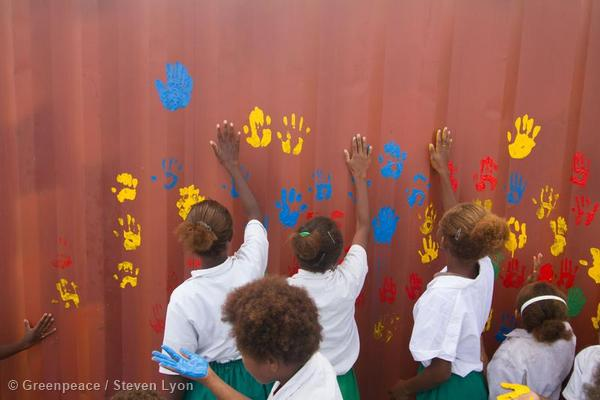 Hand Printing Shipping Containers in Vanuatu