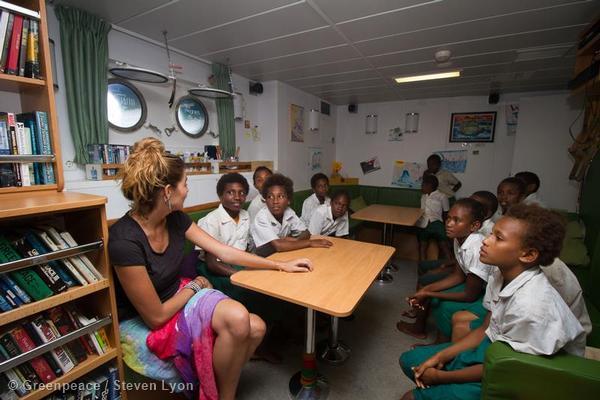 Campaigner Talking to Children in Vanuatu