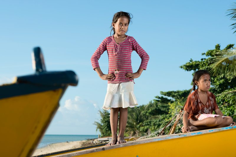 Young Pacific Islanders on a fishing boat