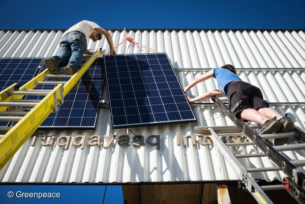 Greenpeace Canada assisting the community in Clyde River to install solar panels.