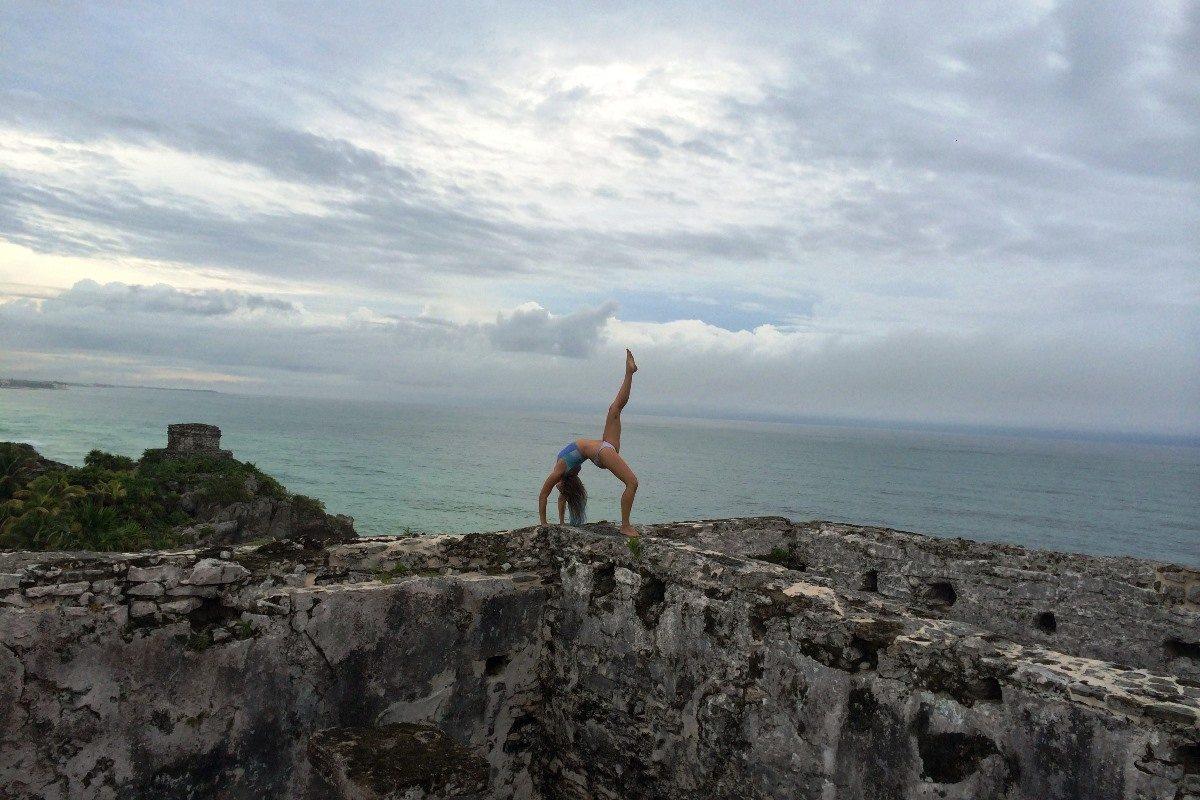 Kate Nelson practising yoga by the ocean, Byron Bay, Australia