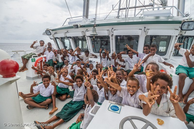 Children from Nambaranguit Primary School have a group photo at the front of Rainbow Warrior. Pentecost Island is one of the outer Islands of Vanuatu hit by Cyclone Pam in March. Greenpeace is in Vanuatu to help deliver relief to outlying islands. After Cyclone Pam devastated Vanuatu, 75,000 people have been left in dire need of emergency shelter and other goods to restore their lives and homes.