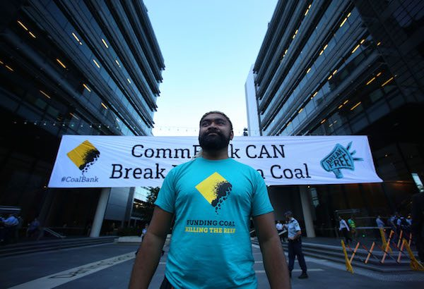 350.org Pacific's Zane Sikulu outside CommBank's HQ in Sydney