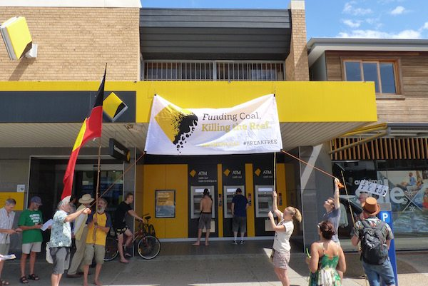 Amazing residents in Byron Bay put up a banner on the CommBank branch saying 'Funding Coal, Killing the Reef'