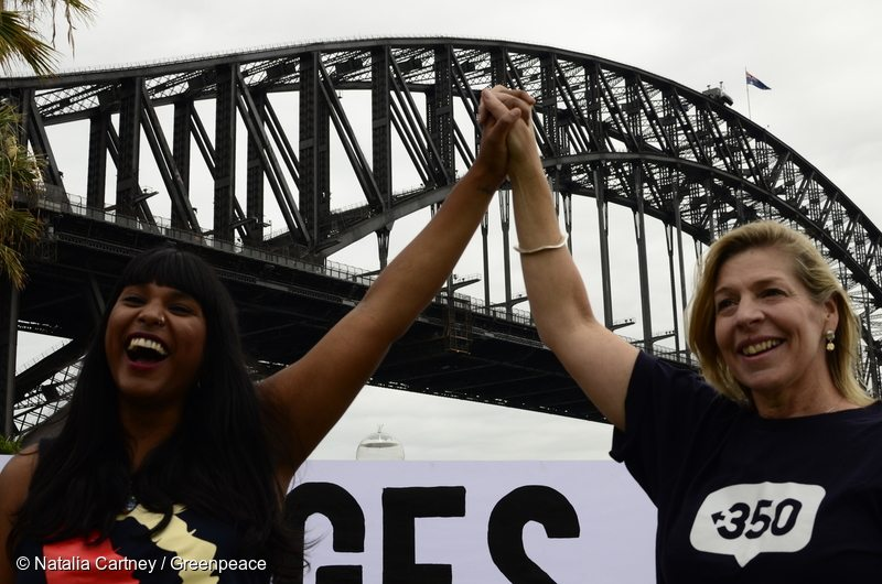 Blair Palese - 350.org CEO Kresta Lokumarambage - Women's March on Sydney organiser Greenpeace Australia Pacific and allies holding 'Bridges Not Walls' banner near the iconic Sydney Harbour Bridge, Sydney Australia. For Trump's inauguration, Greenpeace, showed solidarity in the movement against hate by rising up on bridges across the globe. We symbolically showed that the majority of the planet rejects the divisiveness employed by Trump and other elites.