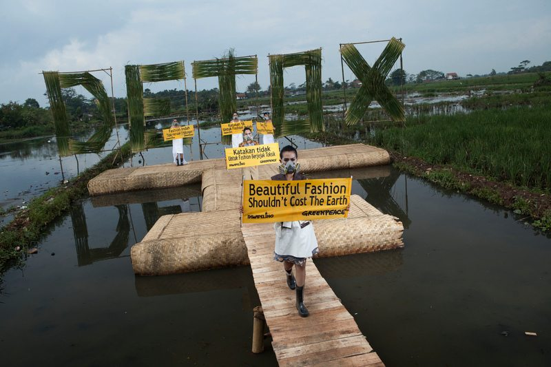 """Indonesian models wear eco fashion apparels designed by Indonesian well known designers Felicia Budi, Indita Karina, Lenny Agustin during """"Detox Catwalk"""" organised by Greenpeace in the polluted paddy field in Rancaekek, West Java province to highlight the toxic pollution brought by clothing industry as well as the idea that 'Beautiful fashion shouldn't cost the earth'."""