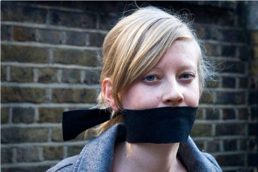 Young woman with a blag cloth gag