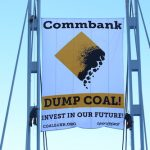 Greenpeace climbers dropped a whopping banner outside CommBank's HQ