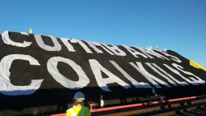 "Community members and Greenpeace occupy the world's largest coal port in Newcastle, New South Wales, Australia, and display the message ""CommBank's Coal Kills"" to highlight the serious health and climate impacts of the Commonwealth Bank's lending policies."