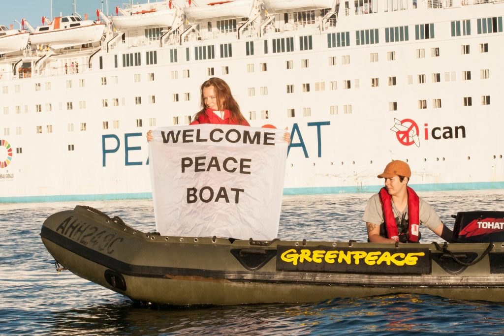 Greenpeace Australia Pacific vessels greet the Peace Boat as it arrives in Sydney Harbour as part of its 'Making Waves' tour to promote nuclear disarmament.