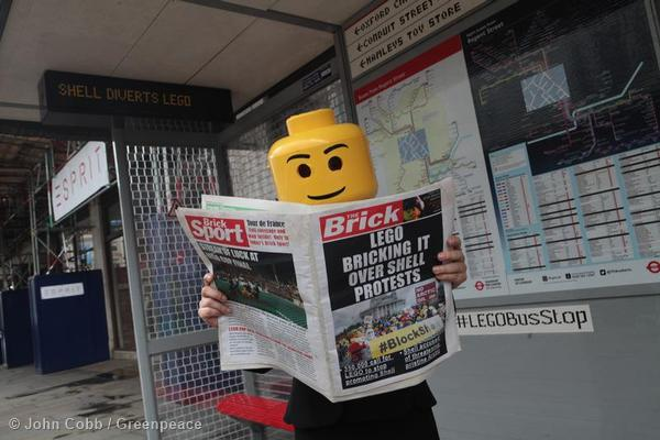 A Greenpeace activist dressed as Lego figure protests at a Lego themed bus stop in Regent Street in central London.