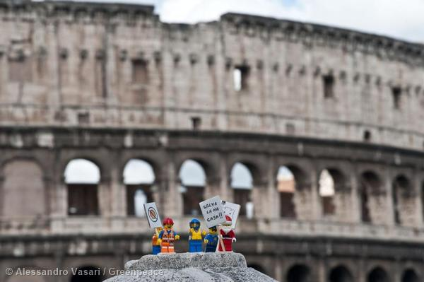 Greenpeace activists place Lego mini figures to protest with banners reading: 'Save the Arctic' against Shell in Rome.