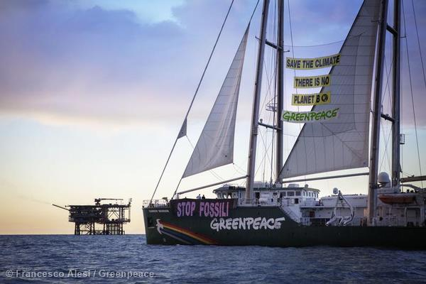 """Activists aboard the Greenpeace ship, Rainbow Warrior unfurl a banner reading: """"No Fossil Fuels"""" and 'Save The Climate, There Is No Planet B"""", as it sails past the Rospo B oil rig off the coast of Vasto. The environmental organisation warns that increased oil drilling activities across the Mediterranean could result in an accident that would cause irreversible damage to environment and livelihoods in the region."""