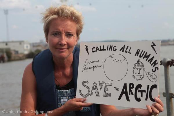 Actor Emma Thompson holds a sign during preparations for her voyage on a Greenpeace ship in August as part of the Save the Arctic campaign.