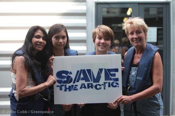 Michelle Thrush, daughter Imajyn Cardinal, Gaia Wise and mother Emma Thompson support the Arctic campaign. They hold a sign during preparations for their voyage on a Greenpeace ship in August as part of the Save the Arctic campaign.
