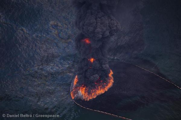 Fire and smoke rise from a controlled burn of oil on the surface of the Gulf of Mexico near BP's Deepwater Horizon spill source. The BP leased Deepwater Horizon oil platform exploded April 20 and sank after burning, leaking record amounts of crude oil from the broken pipeline into the sea.