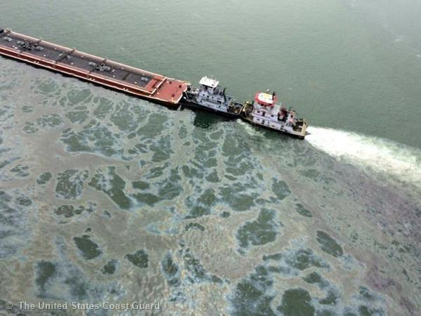 A barge loaded with marine fuel oil sits partially submerged in the Houston Ship Channel, March 22, 2014. The bulk carrier Summer Wind, reported a collision between the Summer Wind and a barge, containing 924,000 gallons of fuel oil, towed by the motor vessel Miss Susan.