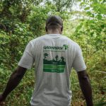 Greenpeace Country Coordinator wearing a Greenpeace Campaign T-shirt in a forest