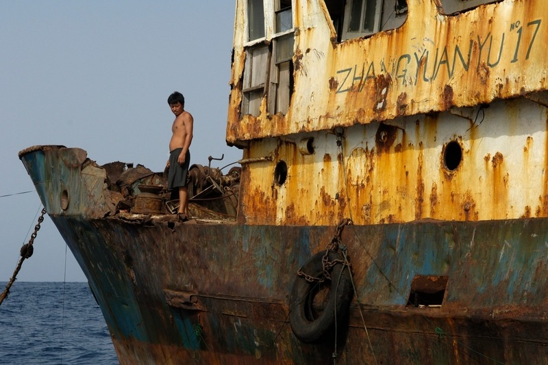 Crew on Rusting Fishing Vessel
