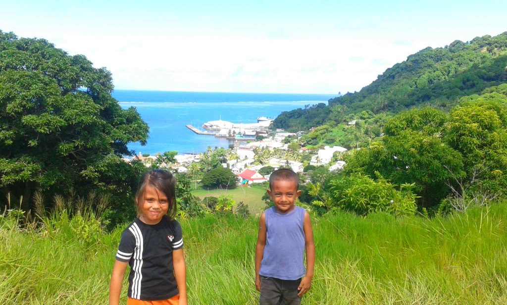 Young Pacific Islanders look out over the coastline
