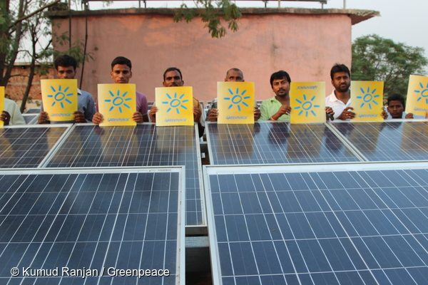 People in Dharnai in Bihar, India, call for climate action and energy from 100% renewable sources ahead of crunch climate talks in Paris. Dharnai had no electricity until a Greenpeace initiative to supply power through solar panels brought energy to the village.