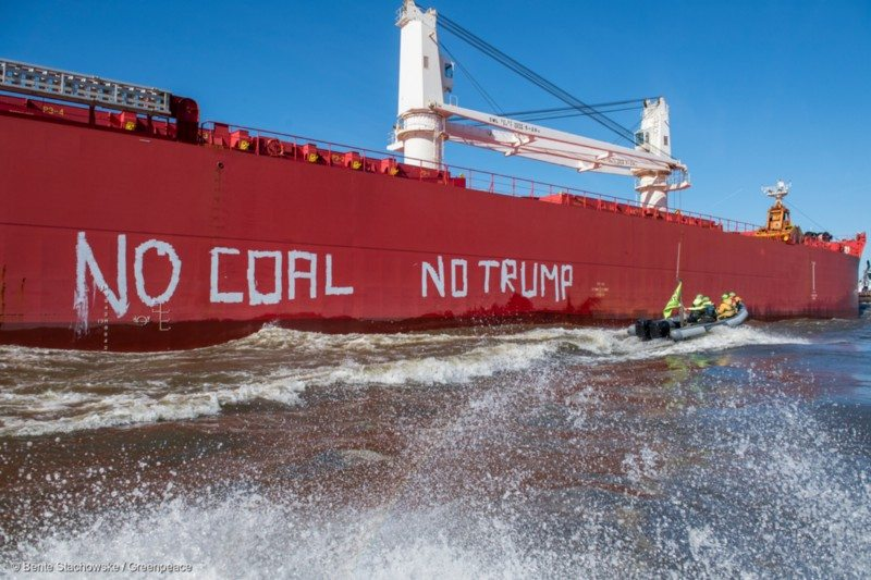 "Greenpeace protest against the ship SBI Subaru filled with 60,000 tons of US hardcoal headed from Texas to Hamburg. Just a few hours before Trump informs the world what role the US will play in the Paris agreement there were dinghys on the river Elbe, swimmers in the water with banners reading ""resist"" ,""no coal"" and ""no Trump"" and the same writing on the vessle's side, sending a clear message to the fossil fuels industry"