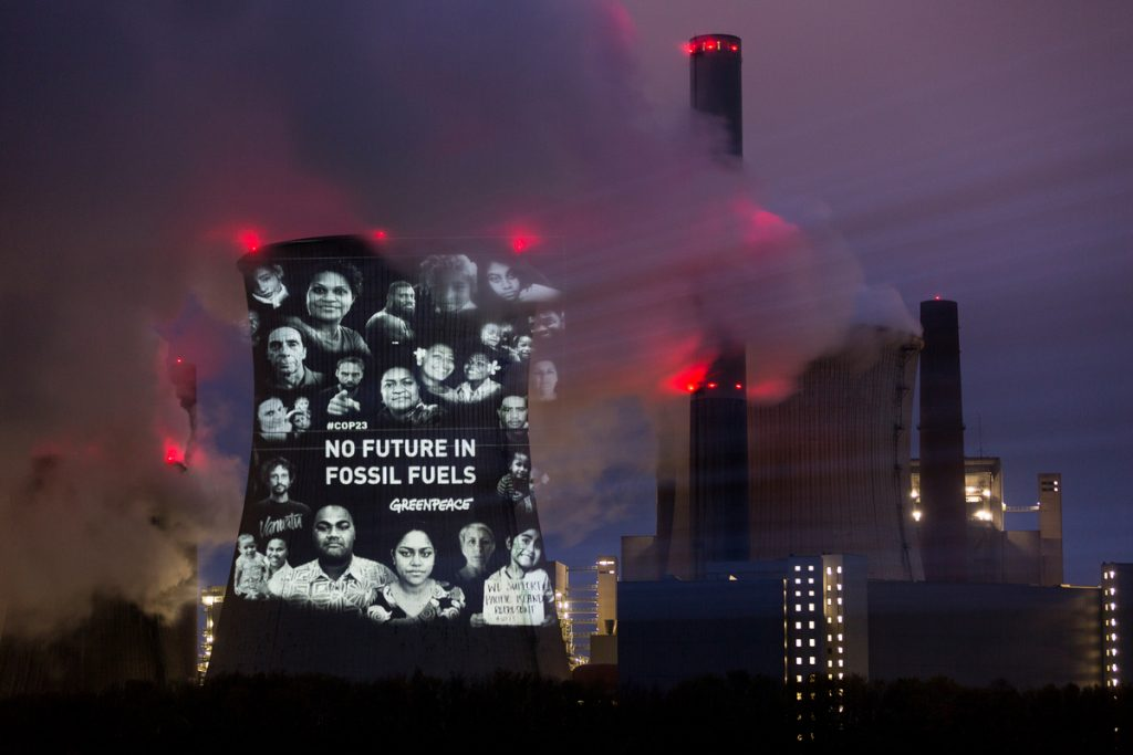 "A Greenpeace action where a message has been projected on a coal-fired power plant to protest against non renewable energy. It reads ""no future in fossil fuels""."
