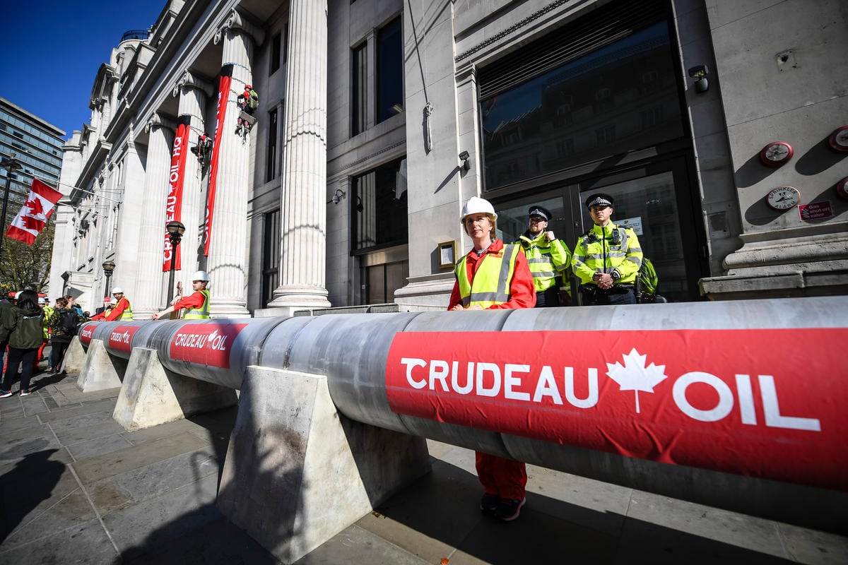 The blockade is a protest against the Trudeau government's plans to build a huge oil pipeline from the Alberta tar sands across indigenous lands to ports in British Columbia. The massive protest pipeline was installed at 6.30am this morning by 30 Greenpeace volunteers and runs from the main entrance of Canada House to the consular entrance on Cockspur Street.
