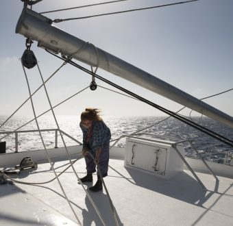 Volunteer dechkand Luca Lamont works the sails on board the Rainbow Warrior III, The Great Australian Bight.