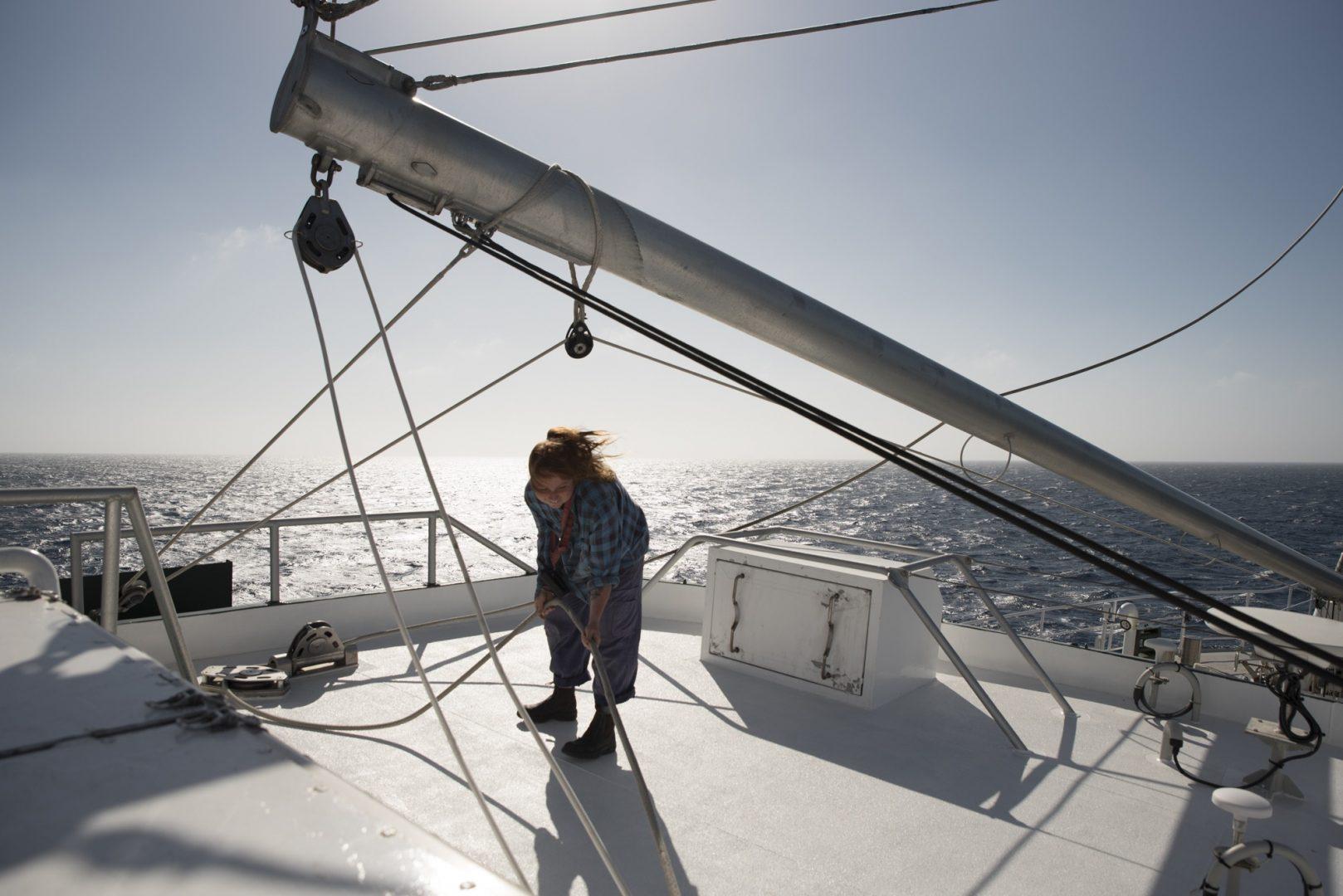 Volunteer dechkand Luca Lamont works the sails on board the Rainbow Warrior III, The Great Australian Bight.
