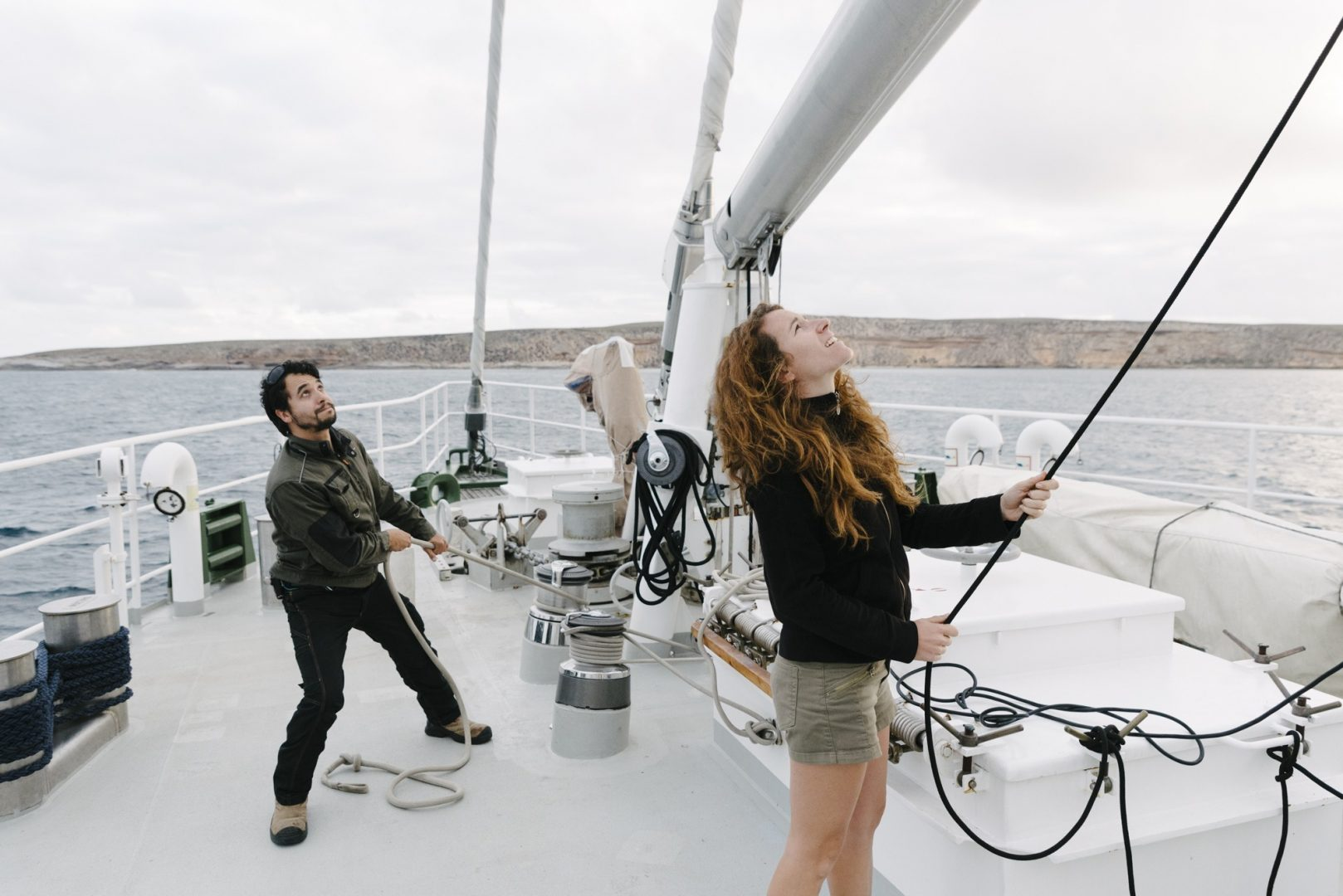 First mate Martina Martinez and Naz adjust te sails on board the Rainbow Warrior III.
