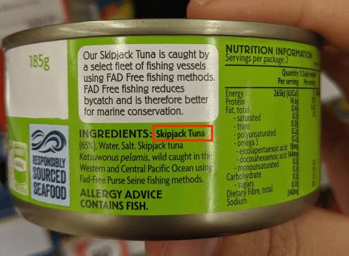 """""""skipjack tuna"""" labelled on a tuna can"""