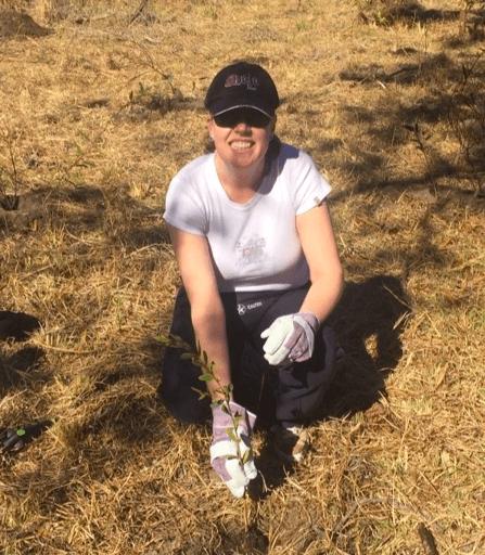 Simone Cooper plants a tree