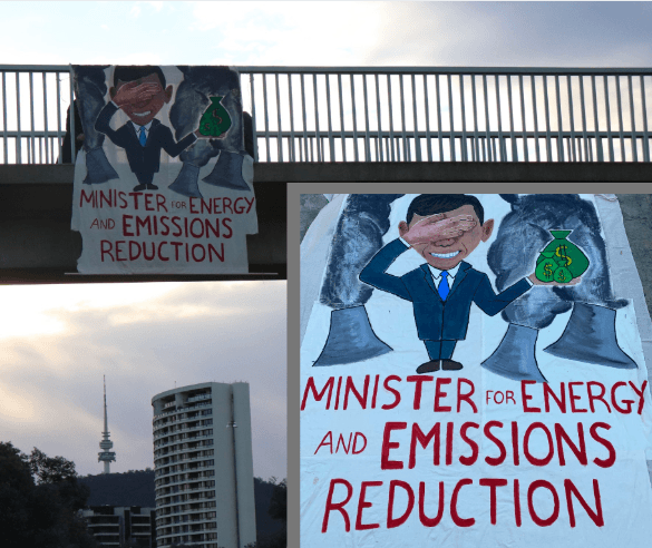Banner showing Angus Taylor handing cash to coal hangs at motorway bridge in Canberra