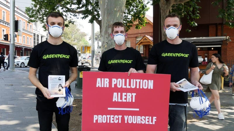 Greenpeace activists distributing P2 dust masks and safety guidelines flyers as Sydneysiders continue to choke under the effects of air pollution.