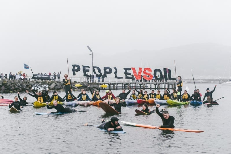 A student-led flotilla including kayaks, sailboats, paddle boards, and surfboards set sail in Apollo Bay Harbour to send a message to oil companies that they are not welcome to drill in the Great Australian Bight.