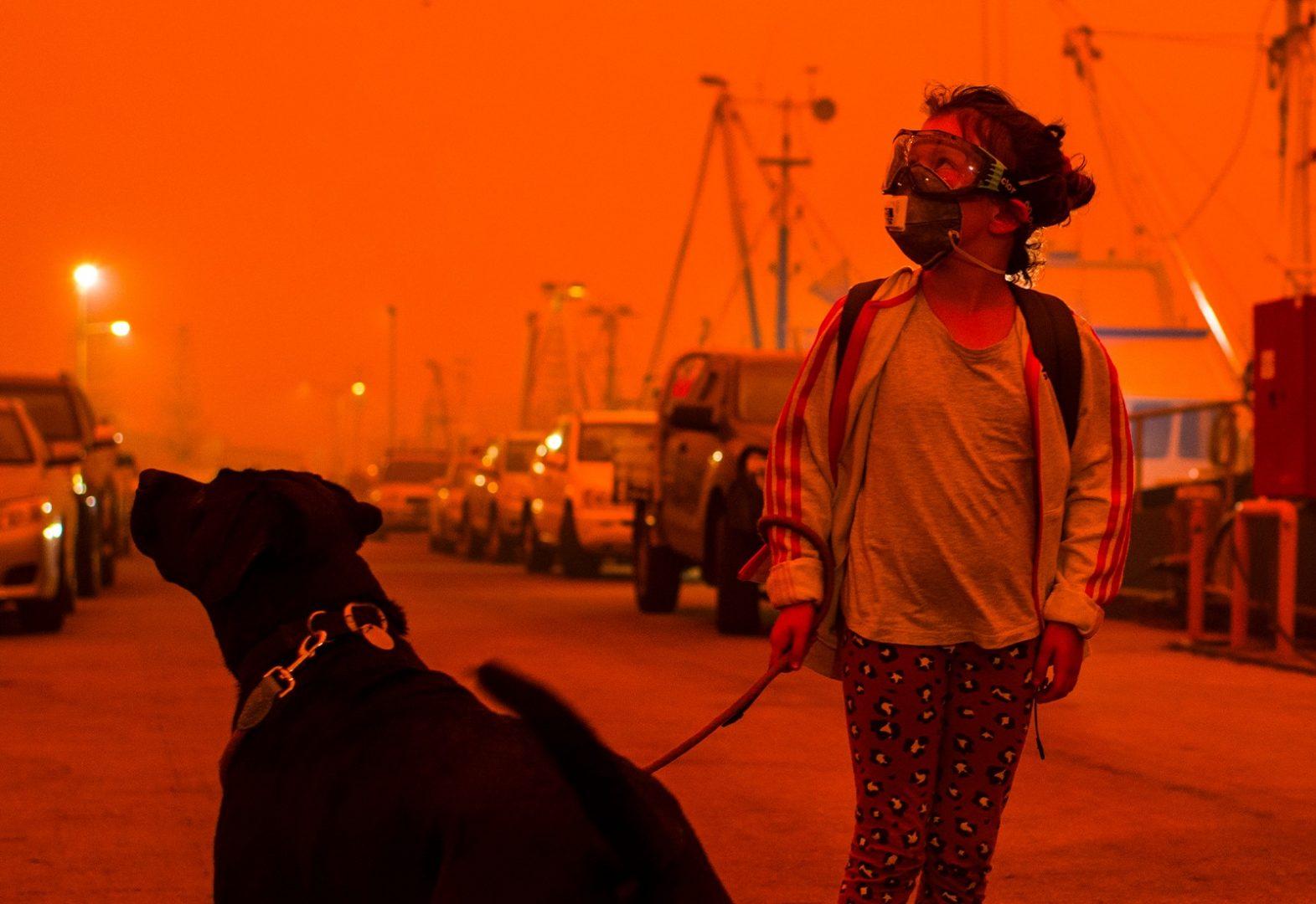 Girl in Mask Walking Dog