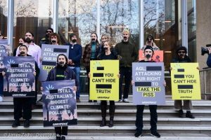 Greenpeace Australia activists in front of the Federal Courts of Australia.