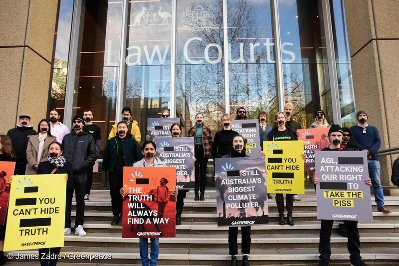 Greenpeace Australia Pacific activists in front of the Federal Courts of Australia.